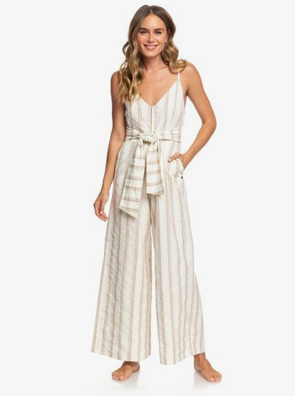 Strappy wide leg jumpsuit for women crafted in mid-weight printed yarn-dyed cotton fabric, designed with flared legs. Complete with adjustable straps.